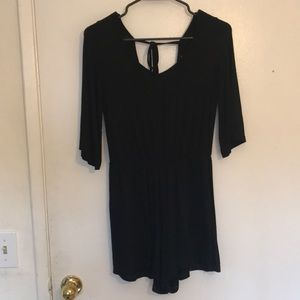 Black romper with open back and cinched waist